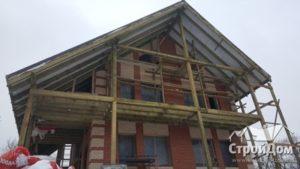 Отделка фасадов загородного дома кирпичом зимой