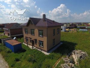 Строительство загородного дома, коттедж из газобетона с отделкой фасадов сайдингом Docke Berg