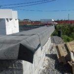 Отсечная гидроизоляция стен загородного дома из газобетона