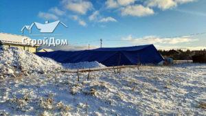 Строительство фундамента загородного дома зимой, тепляк